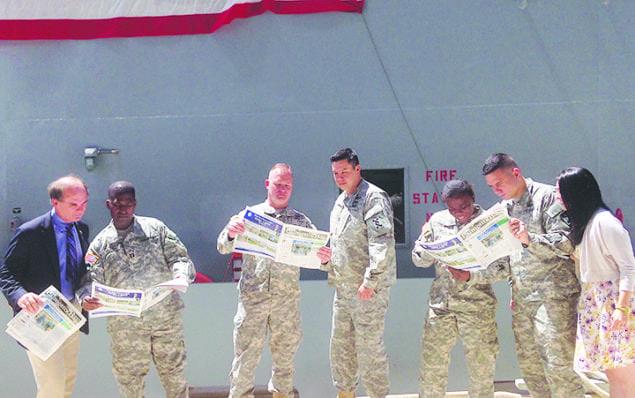 U.S. Army Reservists read the Palmetto Bay News