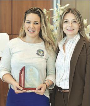 SIB Commissioner Larisa Svechin (right) presents the police award to Civilian Employee of the Year Norelli Liguori.
