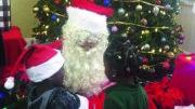 Chef Chris Valdes serves as Santa Claus at Chapman Partnership.
