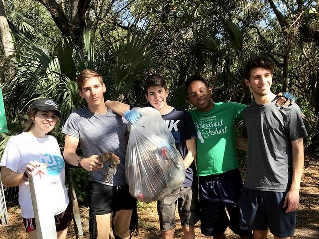 Palmer Trinity School's Eco Club helps clean Kendall Indian Hammocks Park